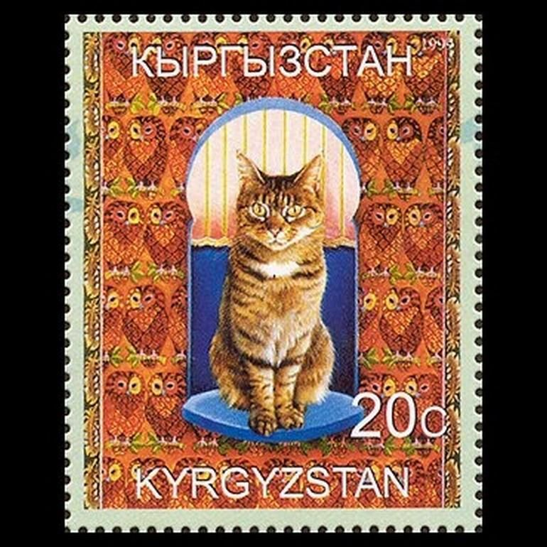 Kyrgyzstan stamp with striped cat on a background of owls! 12-27-2015.