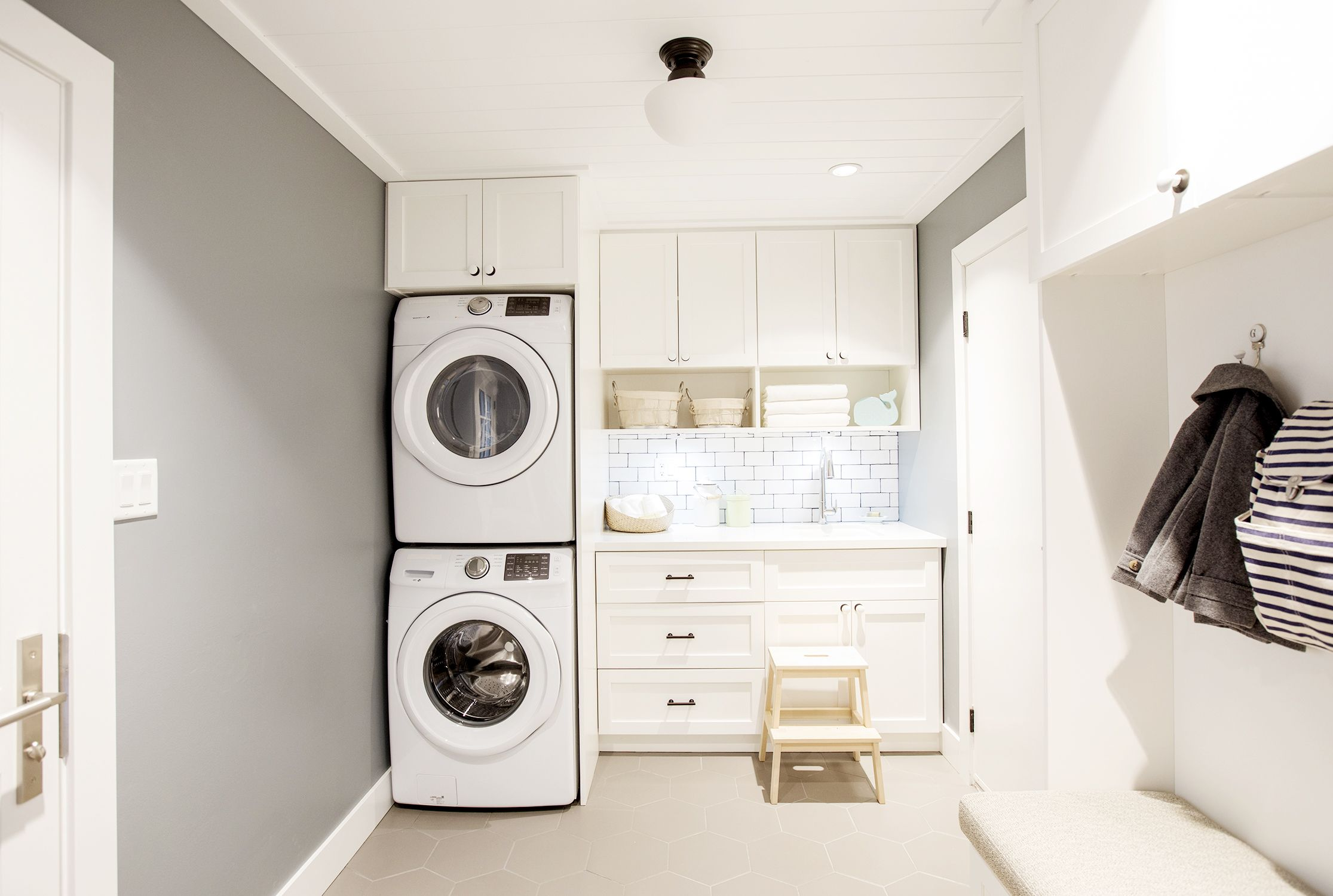 This Open Concept Living Space Packs Style Into Every Square Inch Stacked Washer Dryer Cabinets