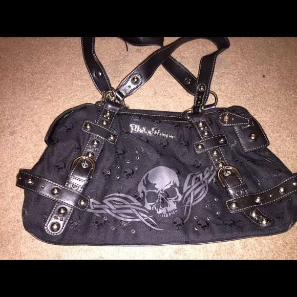 Harley Davidson skull purse Like new condition small unraveling on strap see photo. Zipper clothes 1 zipper back pocket 1 zipper inside pocket 2 side pockets Harley-Davidson Bags Satchels