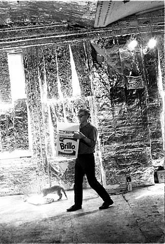 Andy Warhol at the Silver Factory with a Brillo Box. Circa 1960's