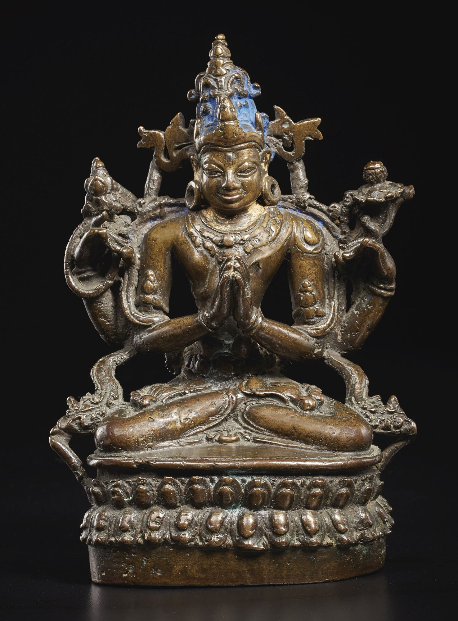 A BRONZE FIGURE DEPICTING CHATURBHUJA LOKESHVARA Eastern