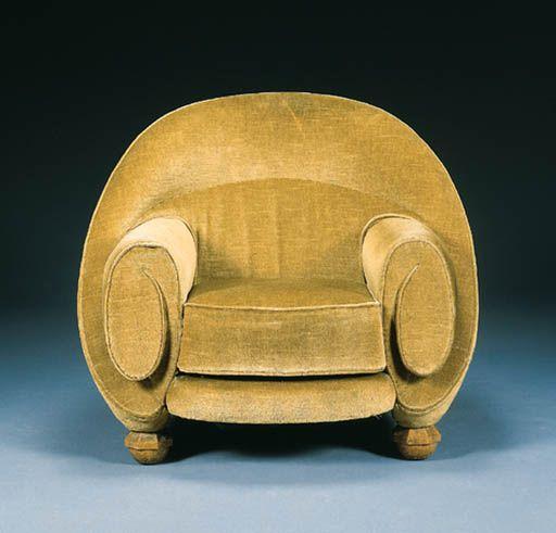 An upholstered armchair,  Pierre Chareau, circa 1925