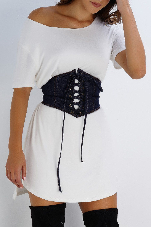 Corset style belt dark wash denim model is wearing size xs