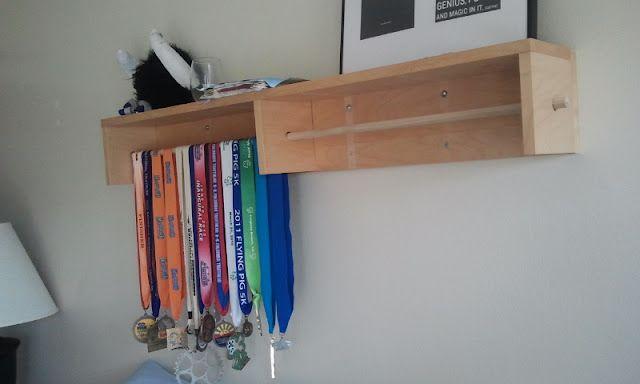 Ikea hackers cd rack turned medal holder organization for Ikea belt hanger