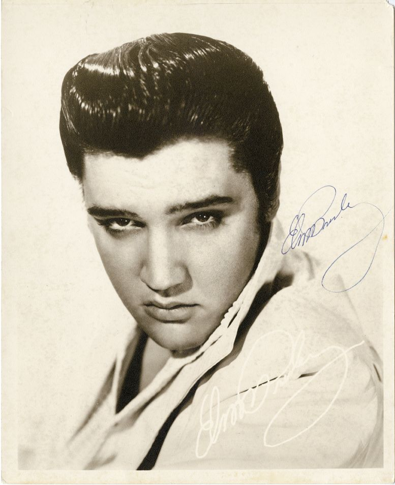 Elvis presley signed photograph black and white 8 x 10 in matte head and shoulders photo of a young elvis presley printed on the photograph in lower