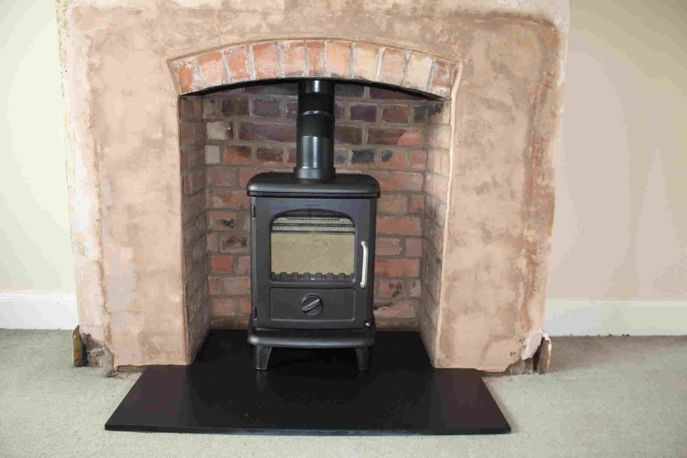 Wood stove in fireplace opening for cabin tinysmaller houses and wood stove in fireplace opening for cabin teraionfo