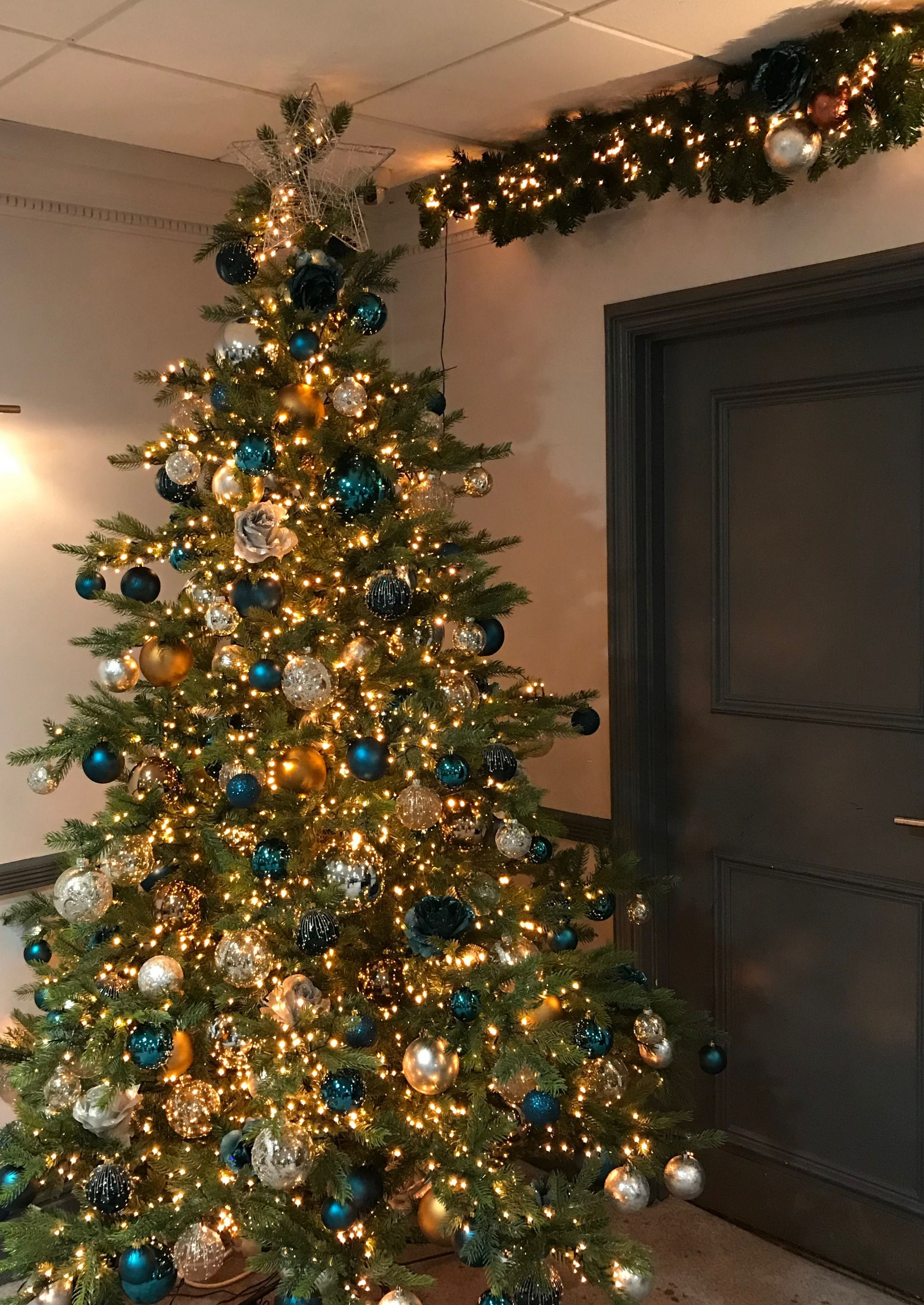 This Artificial Christmas Tree Uses A Copper And Petrol Blue Colour Schem Christmas Tree Colour Scheme Ribbon On Christmas Tree Pink Christmas Tree Decorations