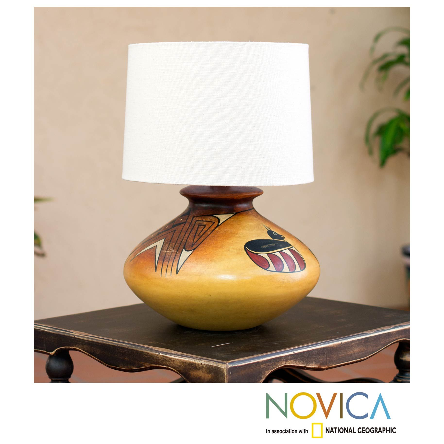 Brighten up your home decor with a lovely handmade lamp Lighting is decorated with arrows and birds that are painted by artist Raul FuenzalidaLampshade features a polystyrene protective cone covered in cotton canvas