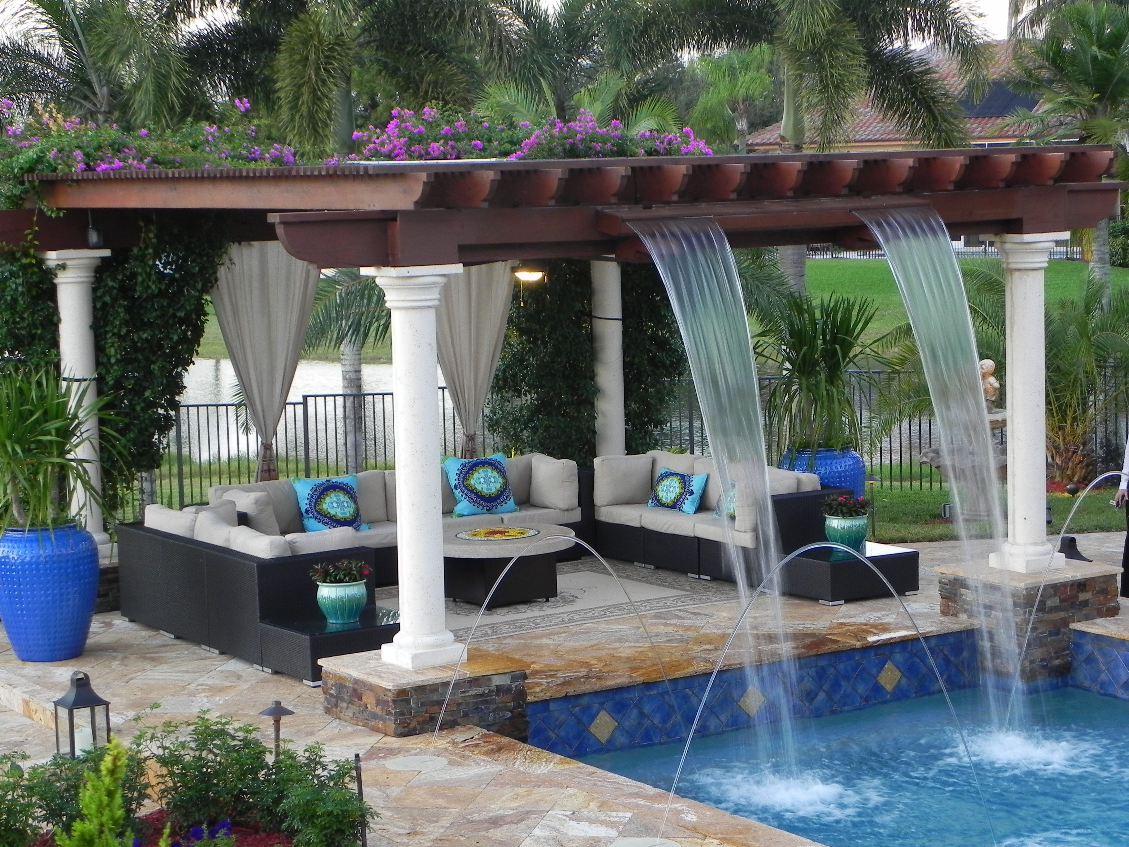 Luxurious custom pool with trellis with waterfall features for Pools by design