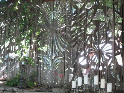 our mirror mosaic fence we had a blast creating this amazing what can come from a, fences, ponds water features, repurposing upcycling, Looks like a jigsaw ran amuck on our fence Seems as though you can see right through to the neighbors yard