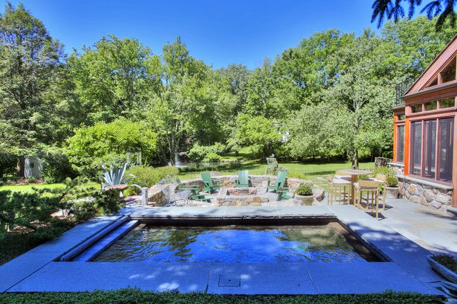 The couple put in the plunge pool, which is also a Jacuzzi, as well as the fire pit. The stone pathways are heated making it easier to use the pool year-round. 'There's nothing more pleasant than the first snow and you're sitting out there in the hot tub,' says Mrs. McPhee.