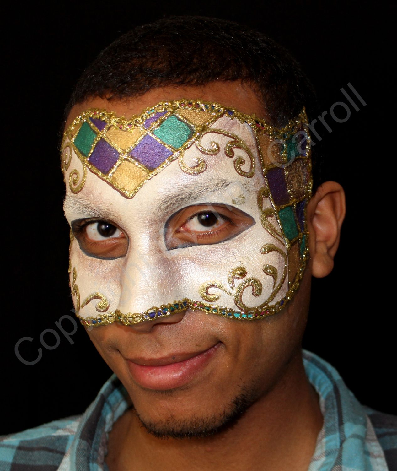 Try a purple, green and yellow combination to represent the traditional Mardi Gras colors. Work in some metallic paints for an old-fashioned look. Paint a jester-style diamond pattern as shown.