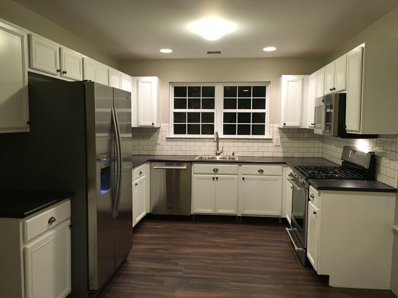 Timeless Kitchen. White Subway tile backsplash with dark