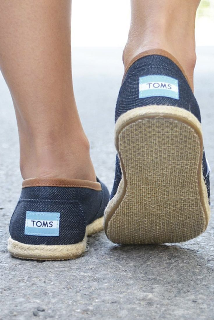 3853f39f714 Step into the giving spirit in TOMS Slip-on shoes. Photo by  Eli G Garcia