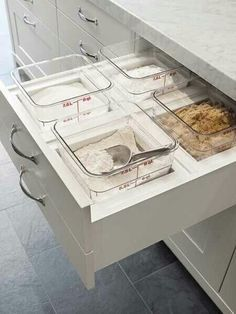 Tips: get more counter and floor space with these hidden storage ideas. Only would add lids.
