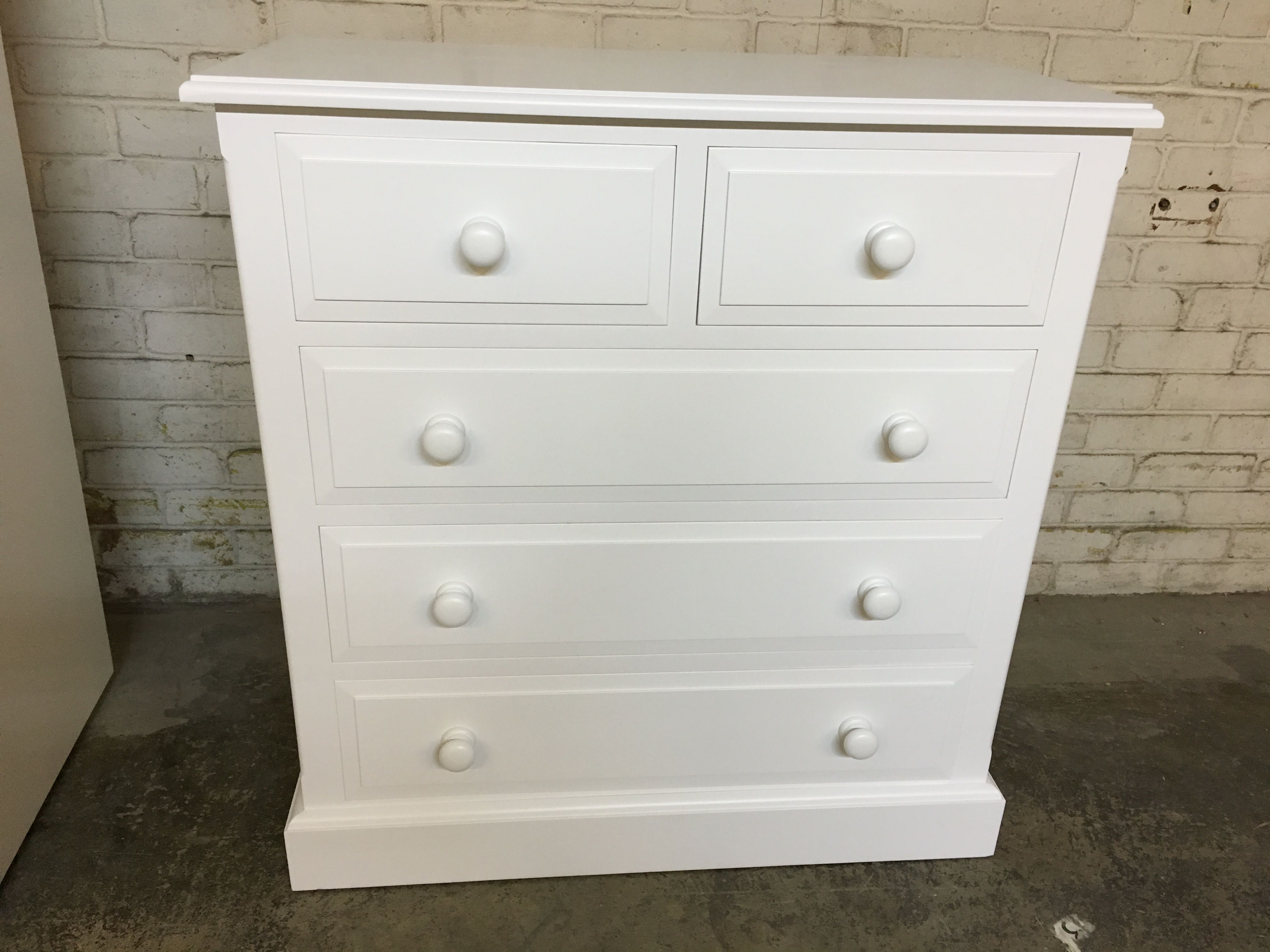 A 2 Over 4 Chest Of Drawers With Traditional Knobs Painted White. Cobwebs  Furniture Company