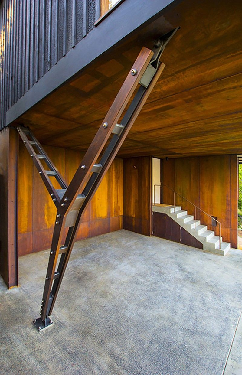 This home is clad in burnt wood and weathered steel to fit for Architectural wood columns