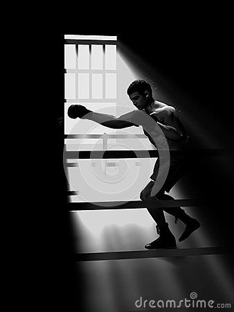 Boxer training under the light entenring by a window.