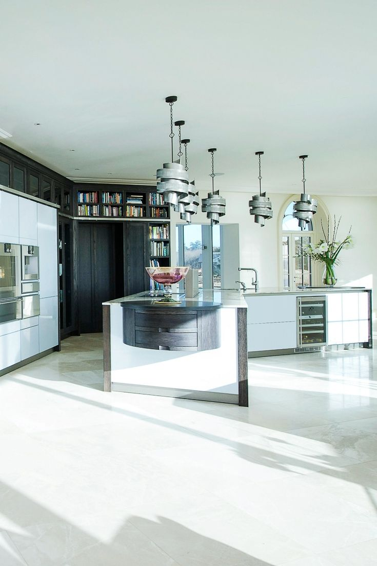 For this project Dream Design combined two styles of kitchen cabinetry. SieMatic S2 appliance housings are encased in Grey Oak Andrew James bespoke furniture. A library style ladder allows access to the upper storage and a concealed automated door grants passage to the pantry.  . . . . . #amazinginteriors #luxurykitchen #luxurykitchens #modernkitchen #kitchengoals #kitchendesignideas  #bespokekitchen #germankitchens #kitcheninspo #beautifulhomes #beautiful #amazing #architecture