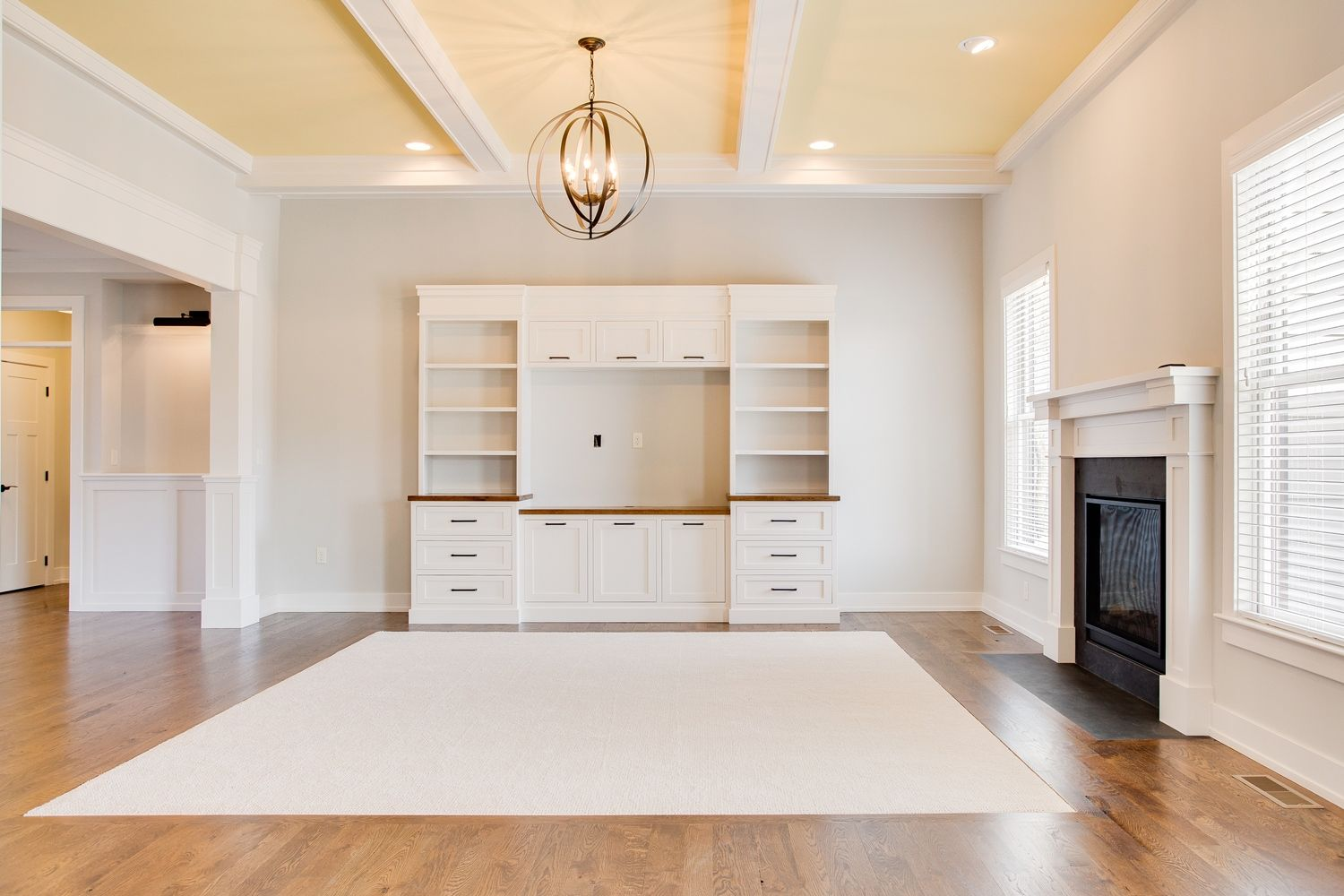 Media Built-in for Family Room - featuring beamed ceiling, white oak ...