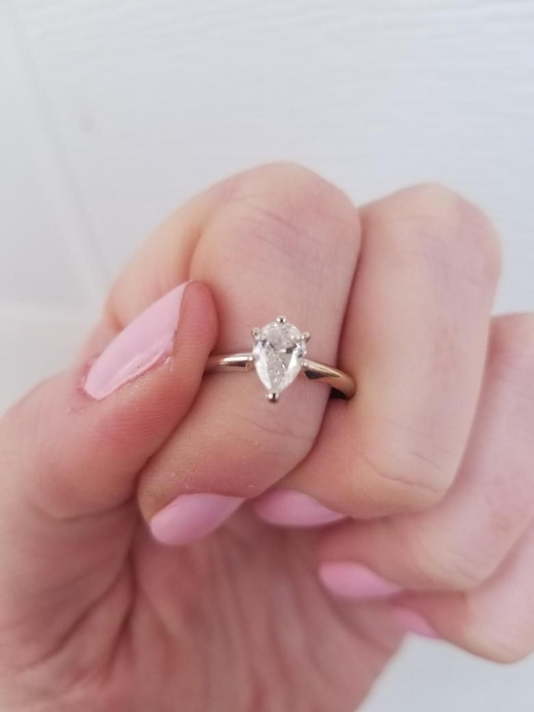 Beautiful diamond engagement ring that features a solitaire pear cut ...