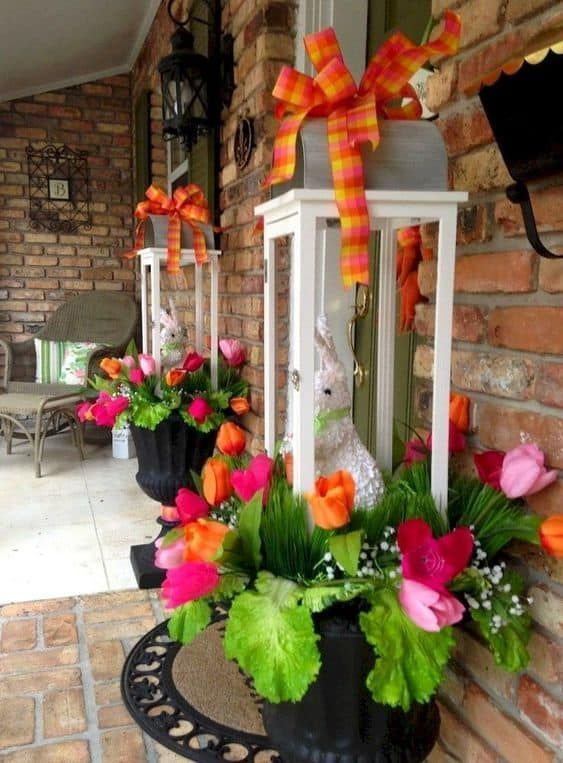 Easter Planter arrangement on a porch #easter #backyardporch #porchIdeas #frontDoorDecor #easter decorating lanterns