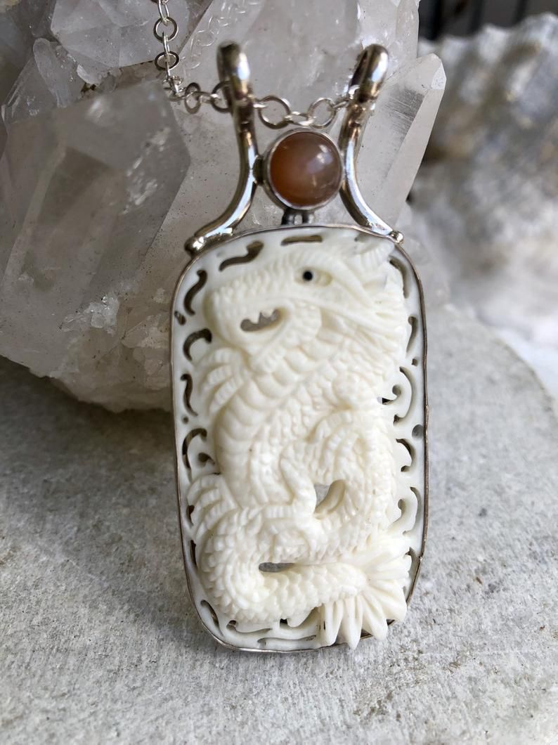 CARVED STONE PENDANT WITH A SALAMANDER