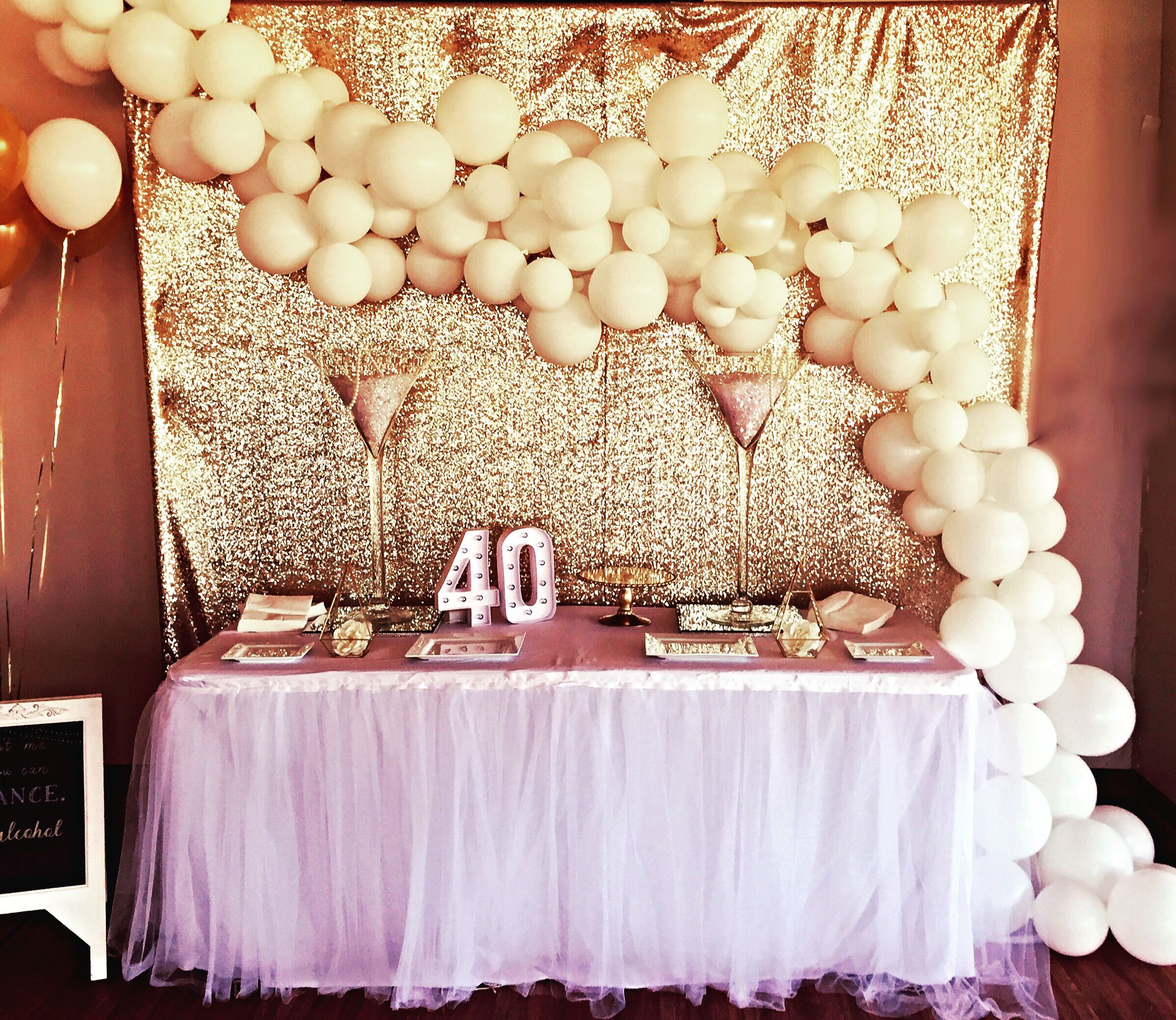 White and gold balloon garland stylish soirees
