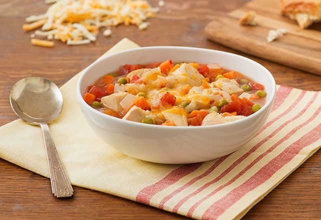 Love a cheesy melt? Broiling (not boiling) is the key to a savory chicken soup with veggies and a satisfying, ooey gooey topping.