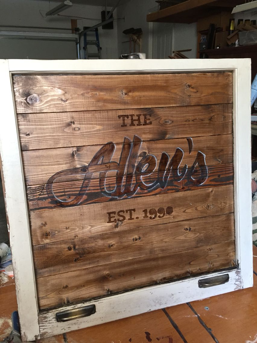 Last name custom wood family sign in an old window frame