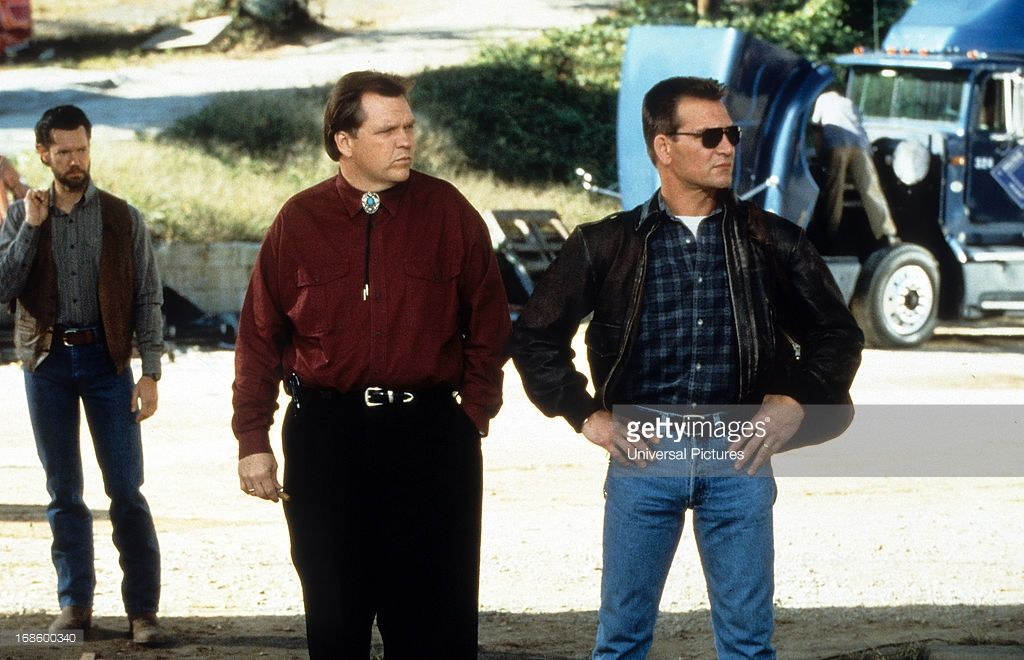News Photo : Meat Loaf and Patrick Swayze standing side by...