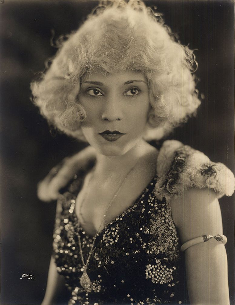 The Black Jean Harlow | 1921     Portrait of an African American vaudeville entertainer, name unknown, sporting a platinum blonde wig. Circa 1921. African American Vernacular Photography courtesy of Black History Album