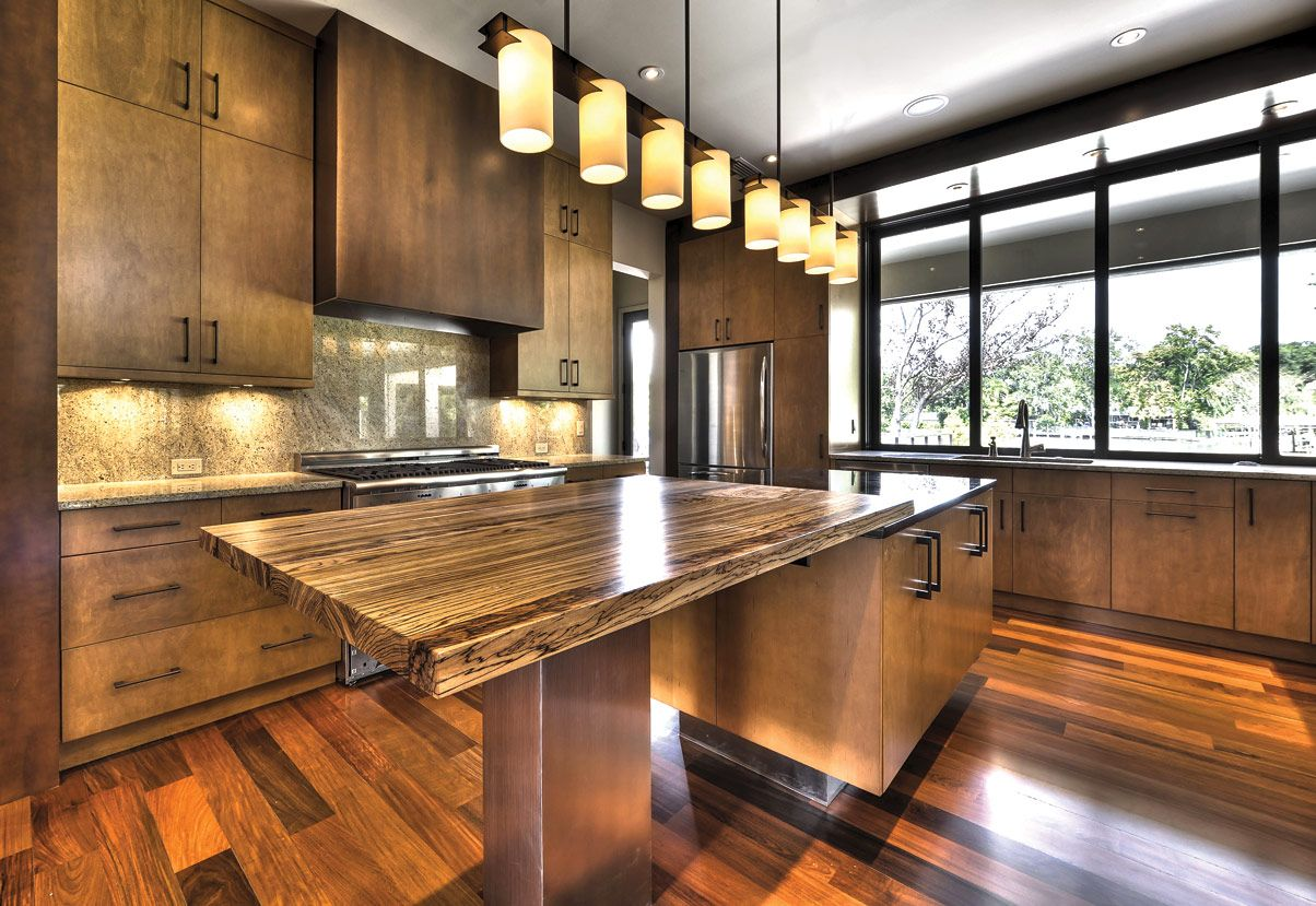 types kitchen countertops wooden floor under long hanging lamps why choose concrete - Kitchen Counter Hanging Lights