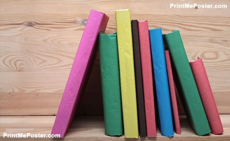 Books on wooden shelf close-up. No labels, blank spine. poster #poster, #printmeposter, #mousepad