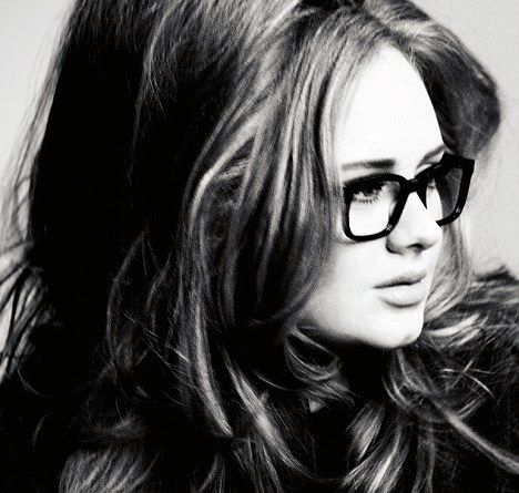 She is so beautiful...the slight cleft in her chin, the glasses, the messy hair.