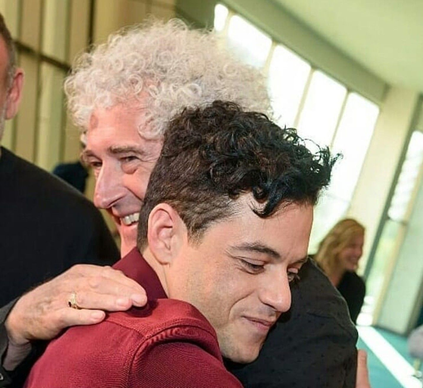 Brian May hugging Rami Malek.