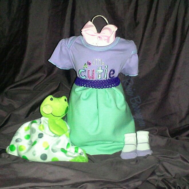 Dress diaper creation. Baby girl outfit, receiving blanket, security plush toy, diapers. Diaper cakes