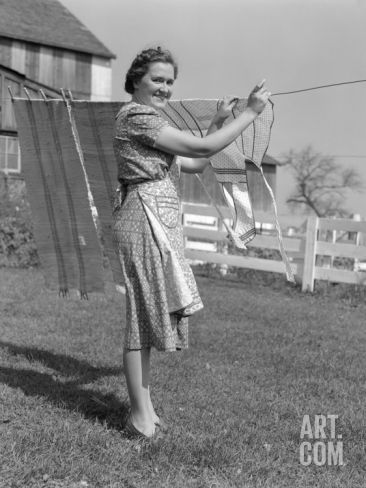 ... Smiling As She is Hanging Laundry on Clothesline Photographic Print