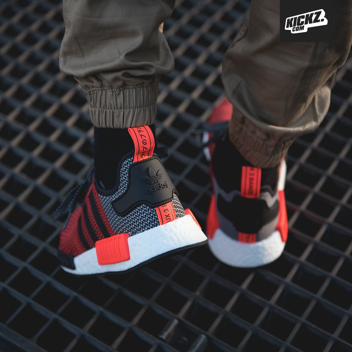 9ca84fce2a6ee Style meets comfort  The adidas NMD R1 lush red core black with Primeknit