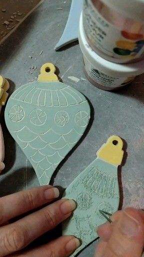 Such a fun and unique way to create handmade Christmas decorations. Underglaze is applied to greenware. Once dry a pattern is scratched or carved into it to reveal the layer underneath. Loving the way these tuenwd out.   #potteryvideo #handmadechristmasdecorations