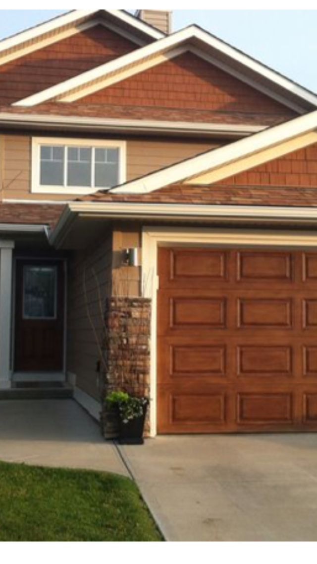 Used Special Walnut Stain On The Metal Garage And Front Door To