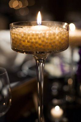 Using floating candles in water pearls, a great idea for a smaller budget, photographs beautifully!