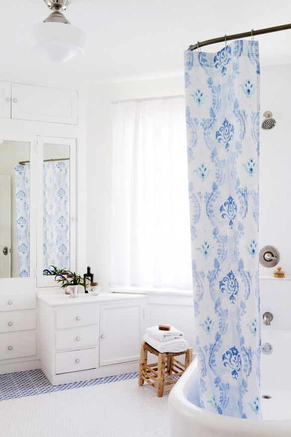 Bright And White Bathroom With Blue Shower Curtain
