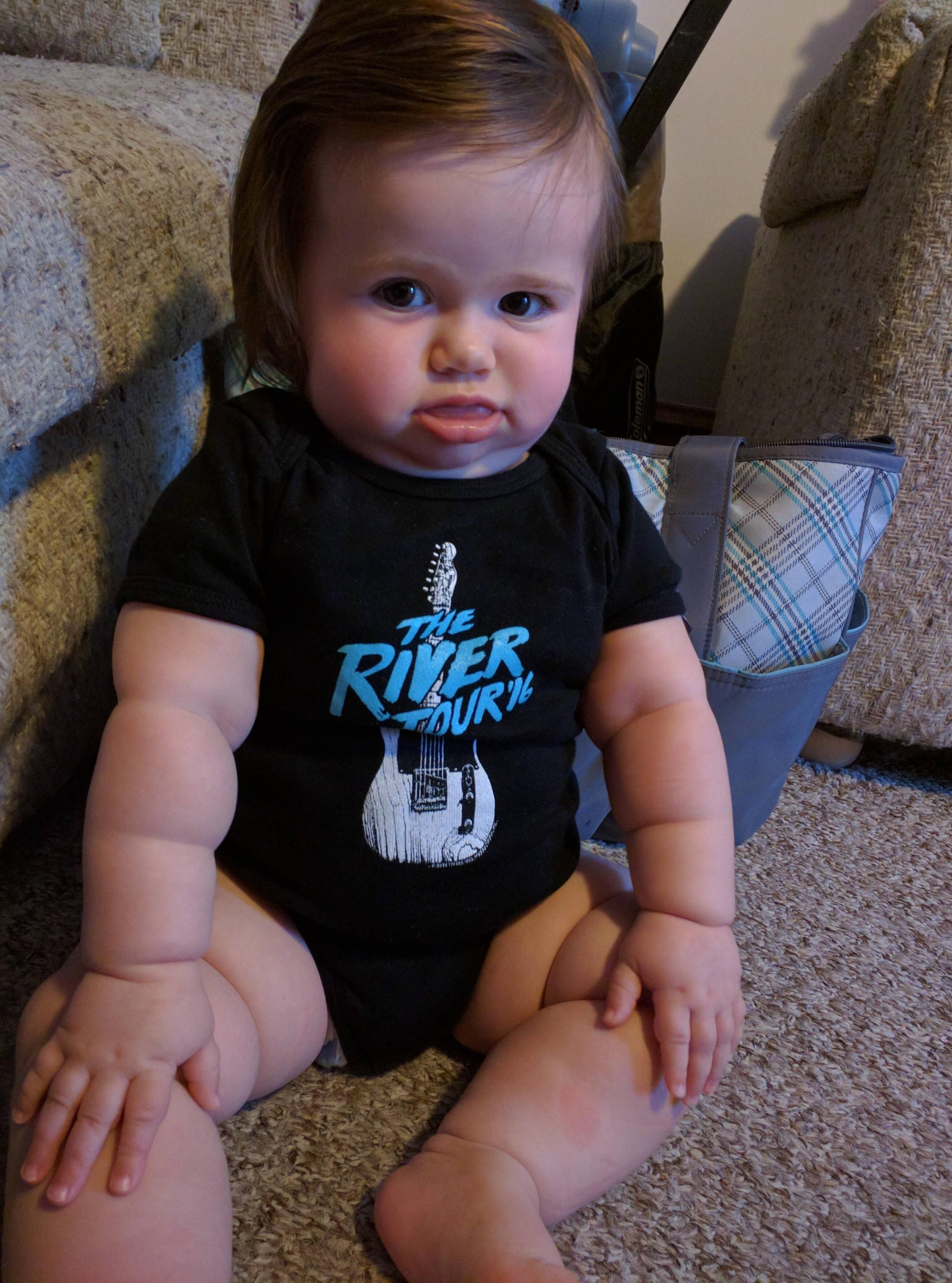 Grumpy babies? Here's Mara in her Springsteen onesie grandma got her. #daddy #love #family #dad #daughter #baby