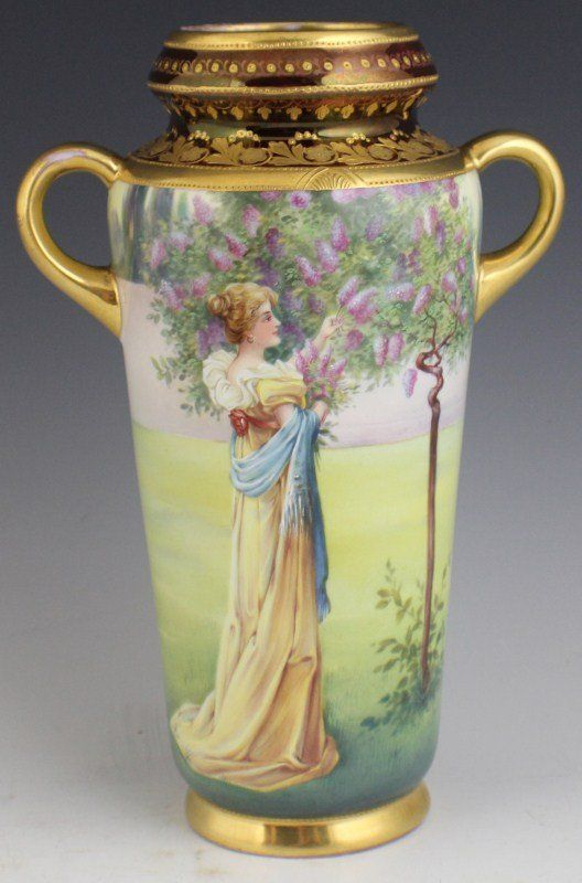ROYAL VIENNA HAND PAINTED PORCELAIN VASE WITH GILDED ENAMEL. PICTURE FEATURES A WOMAN PICKING LILACS. EARLY 20TH CENTURY