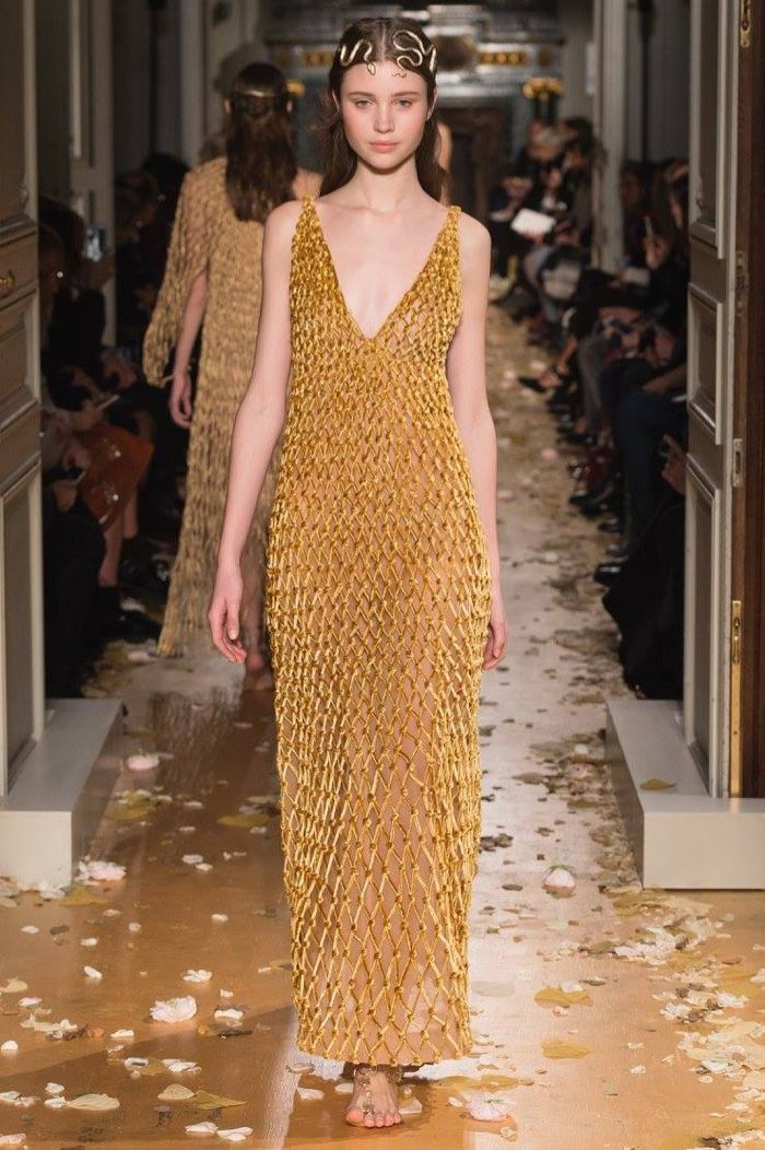 A model walks the runway at Valentino's spring 2016 haute couture collection wearing a macrame dress of velvet and burnished gold