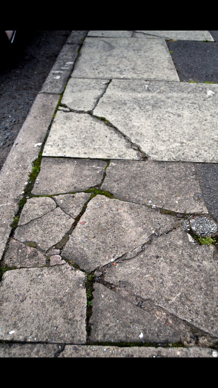 Cracks creating texture in the pavement photo texture