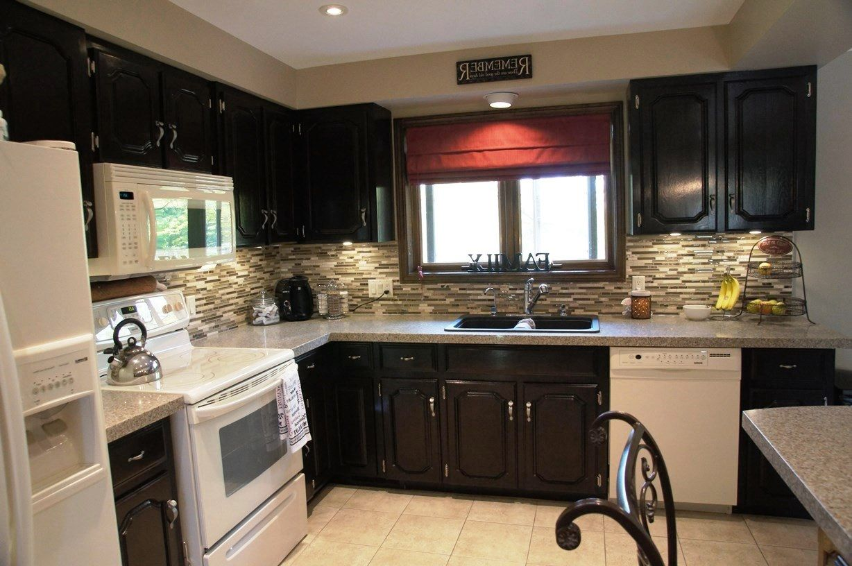 dark wood kitchen cabinets with white appliances house