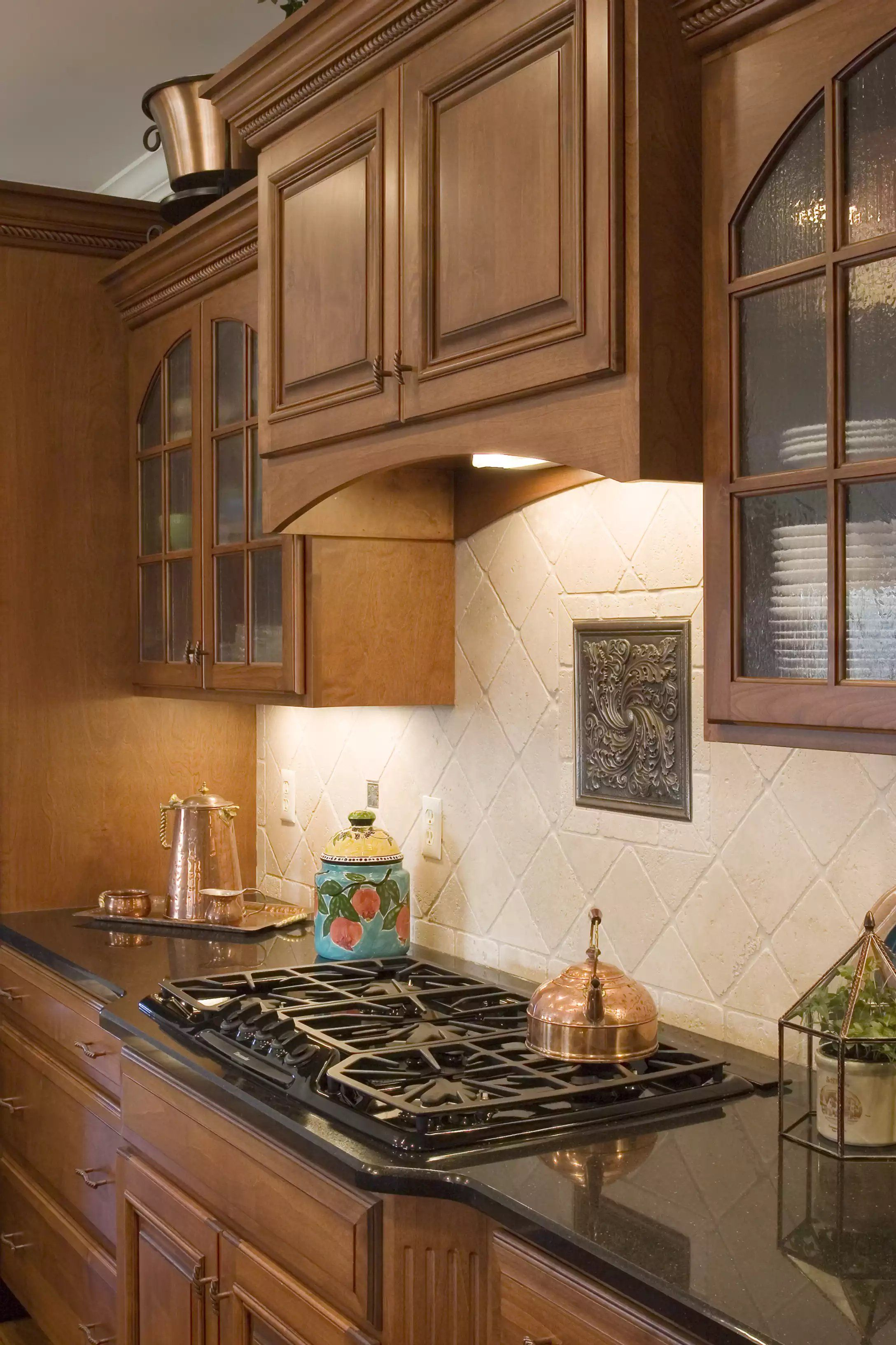 Cool Tone Stained Kitchen Cabinets And Hood With Black Countertop Stained Kitchen Cabinets Cabinets And Countertops Custom Cabinets