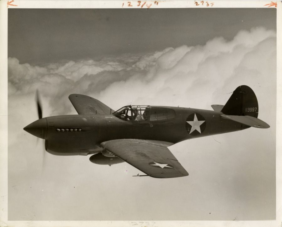 """""""New Curtiss Warhawk fighter for the U.S. Army Air Forces. Shown in this…"""